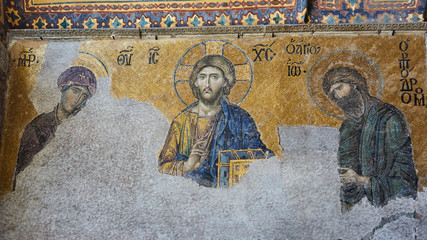 13th century Deesis Mosaic of Jesus Christ flanked by the Virgin Mary and John the Baptist in the Hagia Sophia temple in Istanbul, Turkey.