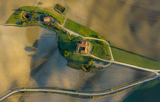 Aerial view of the fields, wineries near San Quirico d'Orcia. Tuscany autumn sunrise