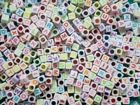 plastic alphabet beads full frame background