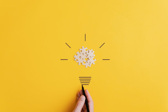 Light bulb over yellow background in vision and idea conceptual image