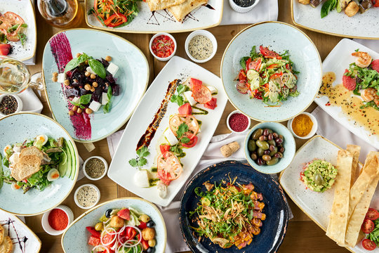 Variety of dishes on the table. Various snacks and antipasti on the table. Restaurant menu. Italian cuisine