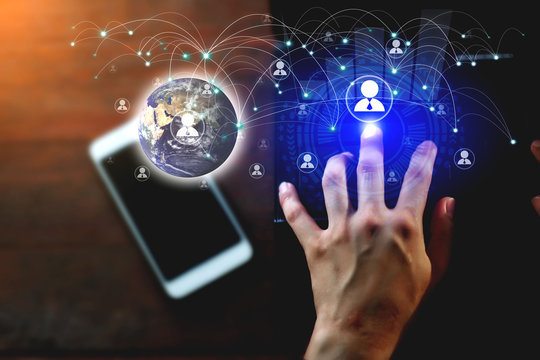 Business people survey customer data Via online networking, social network To communicate in business activities. Communication technology concepts.Element of this image furnished by Nasa