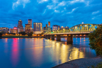 Skyline of Portland, Oregon, USA at dusk, with Willamette River and Hawthorne Bridge