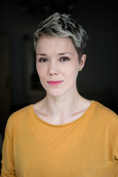 Portrait of smiling woman with dyed short hair