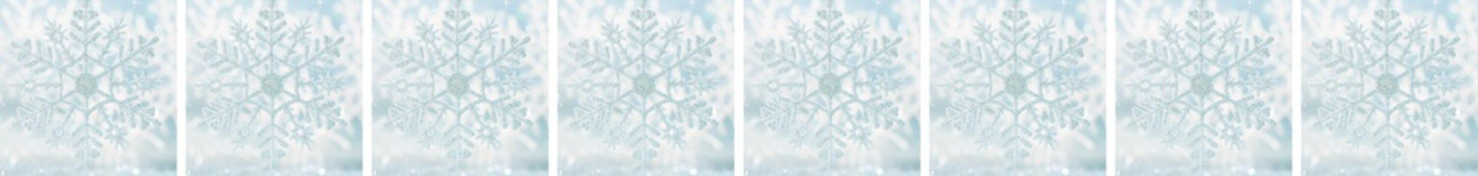 Border snowflake on a blue festive background. Beautiful Christmas background