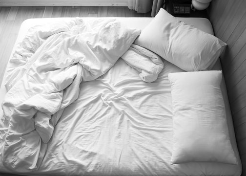 Unmade bed in bedroom. Black and white color tone. Object with copy space background.