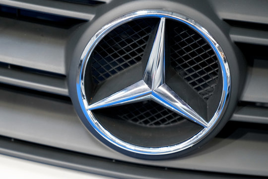 Mercedes logo car modern new in dealership automobiles brand front vehicle