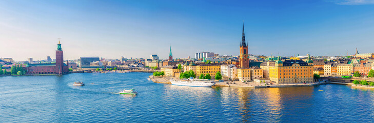 Printed roller blinds Stockholm Aerial scenic panoramic view of Stockholm skyline with Old town Gamla Stan, City Hall Stadshuset, Riddarholmen island with gothic Church building and boat ship sailing on water of Lake Malaren, Sweden
