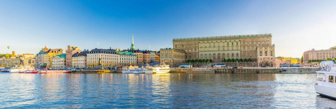 Panoramic view of Old  town Gamla Stan historical quarter with Royal Palace eastern facade (Stockholm slott or Kungliga slottet) on Stadsholmen island, boats in Lake Malaren, Stockholm, Sweden