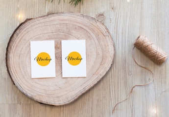 2 Vertical White Business Card on Wood Slice Top View Mockup