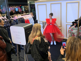 Amel Zamouri, 20, poses for a picture wearing a dress, part of a collection by Italian designer Giambattista Vialli for fashion retailer H&M at a pre-launch happening at a H&M store in Stockholm