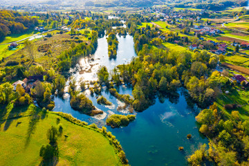 Panoramic view of Mreznica river in autumn from drone, green landscape and waterfalls, Croatia, popular touristic destination
