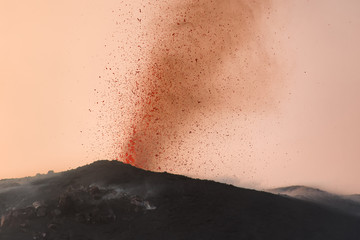explosive eruption with projections of magma and orange smoke  in one of the three craters of the active stromboli volcano, aeolian islands, italy. Fototapete