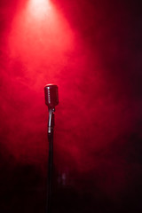 vintage microphone in smoke on red stage
