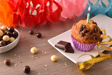 Concept of birthday table with muffin and chocolate elevated