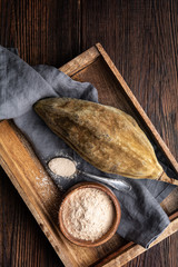 Foto op Canvas Baobab Organic baobab powder in a wooden bowl, healthy sport nutrition rich in vitamins and minerals