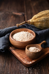 In de dag Baobab Organic baobab powder in a wooden bowl, healthy sport nutrition rich in vitamins and minerals