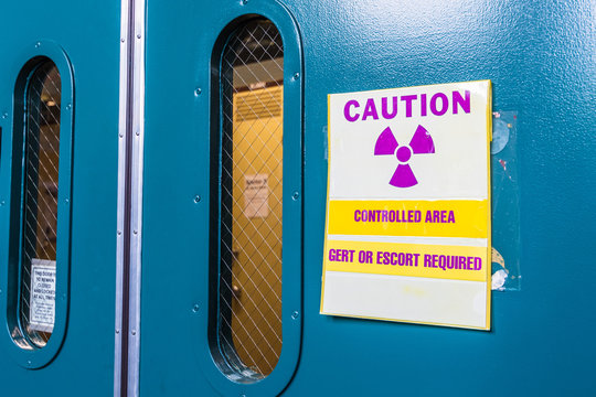 """Ionizing radiation warning symbol displayed at the entrance to a laboratory; Message posted: """"Controlled Area; Gert or Escort Required""""; Gert stands for General Employee Radiological Training"""