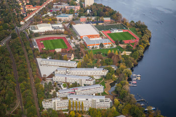 """Potsdam, Germany, district westerly suburb city of Potsdam, with river Havel,  sports park""""Luftschiffhafen Potsdam"""" and Olympic Training Center during early autumn - aerial view"""