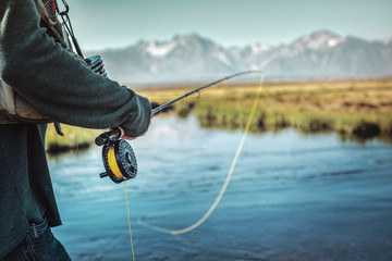 fly fisherman on river