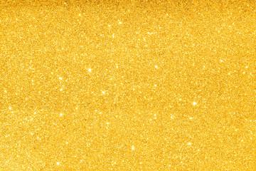 sparkles of golden glitter texture background