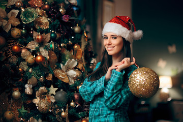 Woman Decorating Christmas Tree with Sparking Ornament