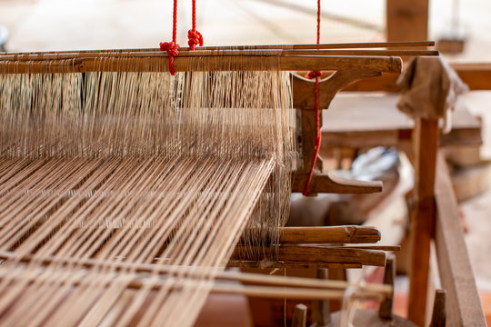 Selective focus of cotton thread on weaver machine. Abstract background of fabric weaving in vintage weaver machine. to design element background banner and artwork