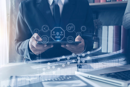 Double exposure, Businessman working on digital tablet, with hologram analysis increasing financial graph. network icon.