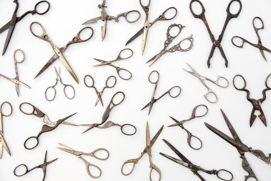 top view of various scissors on white background