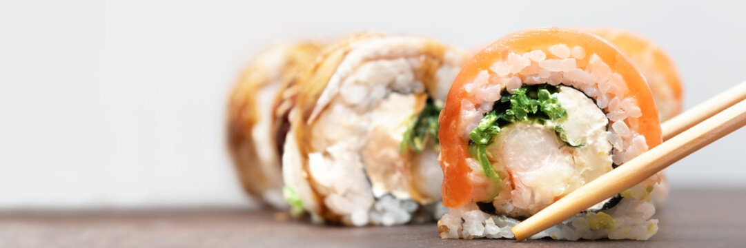 Homemade Sushi roll with salmon and cream cheese, banner.