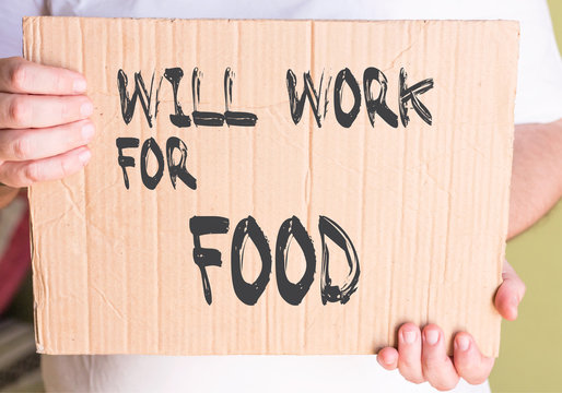 """businessman holding """"Will Work for Food"""" sign at street"""