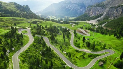 Wall Mural - Winding road at Passo Gardena, Dolomites, aerial view
