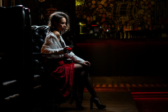 girl alone at the bar drinks