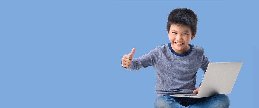 Asian Little kid with pile of books and laptop lying on white background, Education Learning School Concept