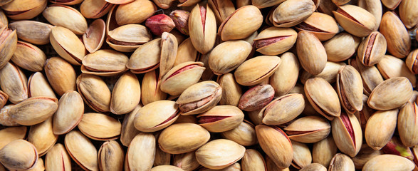 Pistachios with shell full background, banner, closeup