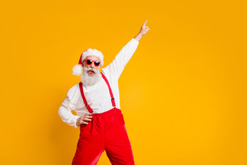 Christmas party hard. Portrait of crazy funny santa claus hipster in red hat enjoy x-mas noel...