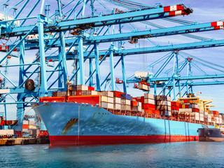 container ship in the habor of Algeciras, Spain, loading and unloading container