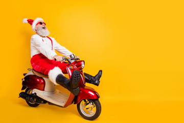 Full body photo of crazy santa white hair grandpa rushing x-mas party speed by retro bike wear...