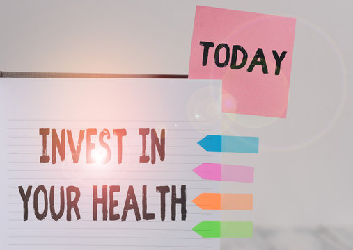 Word writing text Invest In Your Health. Business photo showcasing Live a Healthy Lifestyle Quality Food for Wellness Hard cover note book sticky note arrow banners inserted clear background