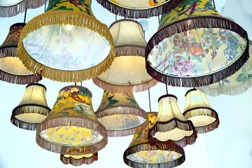 Antique or vintage lampshades hanging in a display group