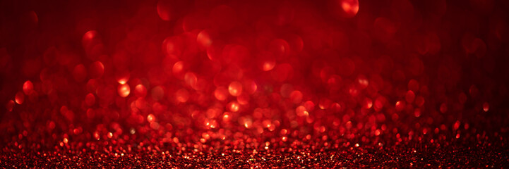 Banner 3:1. Abstract glitter lights on red background. Christmas greeting card. Christmas or New Year celebration concept. Copy space. Soft focus. Fototapete