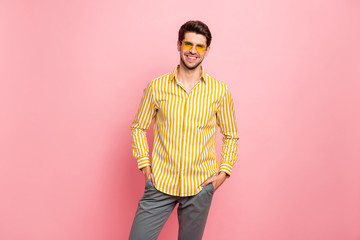 Photo of handsome macho guy holding hands in pockets summer sunny day wear sun specs stylish...