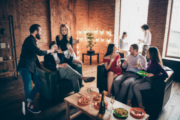 Photo of eight members group festive birthday party people friendship chatting clinking glasses drink golden wine eating snacks wear formalwear sitting sofa indoors