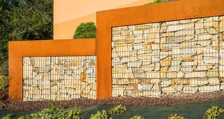 Modern garden wall made of gabions and corten steel