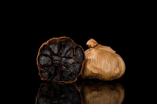 Black garlic on dark background.