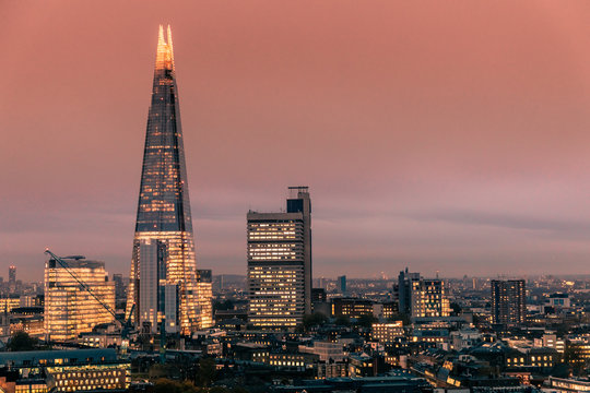 Modern London city skyline with shard building at sunset night