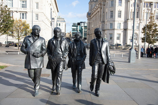 Liverpool, UK - October 30 2019: A statue of the Beatles band stands in Liverpool city, sculpted by Andrew Edwards