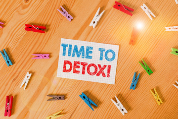 Handwriting text writing Time To Detox. Conceptual photo when you purify your body of toxins or stop consuming drug Colored clothespin papers empty reminder wooden floor background office