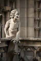 Close up of chimera figure on the roof of undamaged Notre Dame de Paris, Paris, France