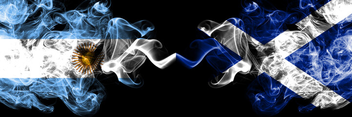 Argentina vs Scotland, Scottish smoky mystic fire flags placed side by side. Thick colored silky abstract smoke flags concept